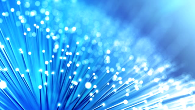 vídeos de stock e filmes b-roll de fiber optic cables - global data transfer background (version 1, bright) - loop - fibra ótica