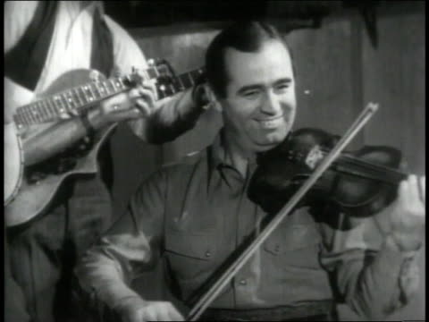 1946 montage fiddler and banjo player provide the soundtrack for square dancers - violin stock videos & royalty-free footage
