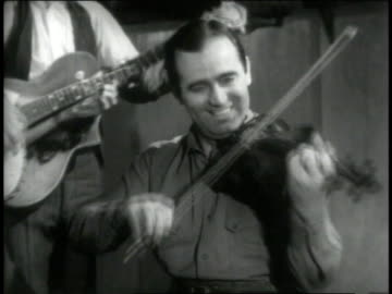 1946 montage fiddler and banjo player smile as they provide the soundtrack for square dancers - 1946 stock videos & royalty-free footage