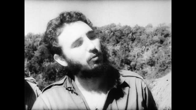 / fidel castro and his band of rebels living life in and around their mountain camp / castro dictates to a listening crowd of women and children /... - 1958 stock videos & royalty-free footage