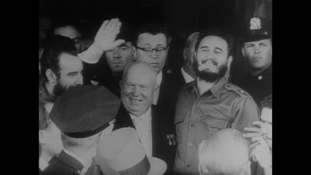 stockvideo's en b-roll-footage met fidel castro and nikita khrushchev in new york as they leave united nation's building - cuba