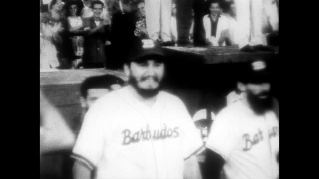 / fidel castro plays baseball to raise awareness for agrarian land reform / president osvaldo dorticos torrado throws first ball / game played to... - fidel castro stock videos and b-roll footage