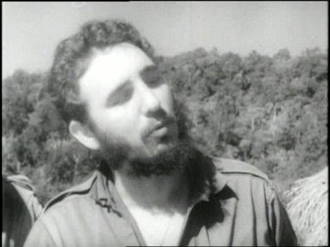 vidéos et rushes de fidel castro points at a map while talking to rebels - révolution cubaine