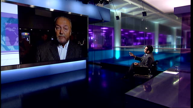 fidel castro steps down as president england london gir int george galloway mp live 2way interview from manchester sot says that the channel 4 news... - fidel castro stock videos and b-roll footage