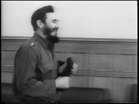 Fidel Castro walking thru room embracing Nikita Khrushchev / newsreel
