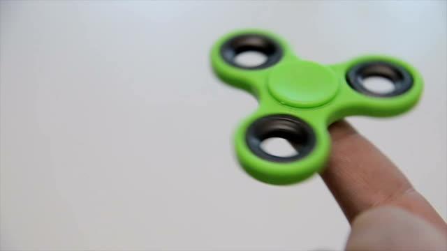 Fidget spinner in the men's hands,close up