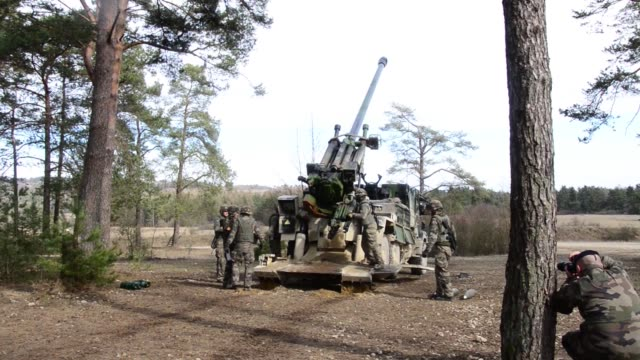 field artillery french soldiers fire a caesar 155mm .52-caliber self-propelled howitzer as part of exercise dynamic front 19 at grafenwoehr training... - howitzer stock videos & royalty-free footage