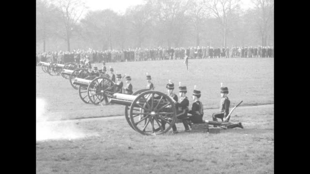 field artillery guns are pulled thorough london's marble arch / spectators at edge of field in hyde park / vs cannons are fired in grassy field with... - member of the scottish parliament stock videos & royalty-free footage
