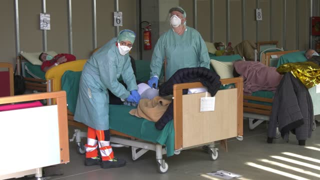 field hospital is organized near the city hospital, health personnel organize the work to carry out the covid-19 tests on march 18, 2020 in brescia,... - female nurse stock videos & royalty-free footage