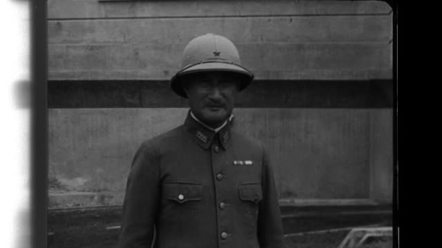 vídeos de stock e filmes b-roll de field marshal hisaichi terauchi poses in the southern army group general headquarters and then departs in a staff car - 1943