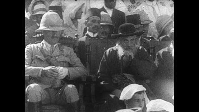 field marshal sir edmund allenby sitting in chair next to unidentified male in hat at outdoor gathering middle east setting c1925 - imperium bildbanksvideor och videomaterial från bakom kulisserna