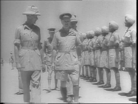 vídeos de stock, filmes e b-roll de field marshall sir archibald p wavell becomes britain's viceroy to india as united nations point to possible burma offensive / wavell walks among... - guerra do pacífico
