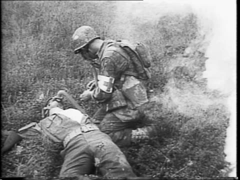 field medics pose with equipment / soldiers running over bridge during training exercise for medics, a soldier falls down, there is an explosion, and... - allied forces stock videos & royalty-free footage