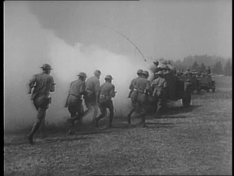 field of soldiers walk across a field / soldiers training / soldier douses rags wrapped around a bottle with gasoline / soldier throws flaming... - molotov cocktail stock videos and b-roll footage