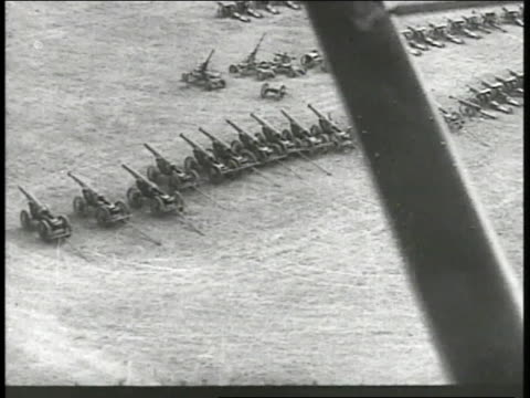 field of surrendered polish artillery ms stacked rifles piles of other supplies weapons near artillery guns - 1939 stock videos & royalty-free footage