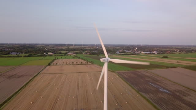 field of wind turbines - hay bale stock videos and b-roll footage