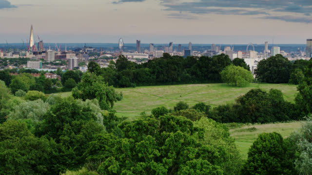 fields and ponds on hampstead heath with london skyline - aerial - parliament hill stock videos & royalty-free footage