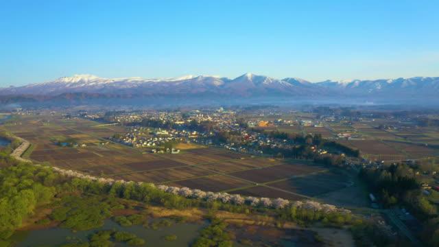 ws aerial fields and town of shizukuishi, iwate prefecture, japan - mountain range点の映像素材/bロール