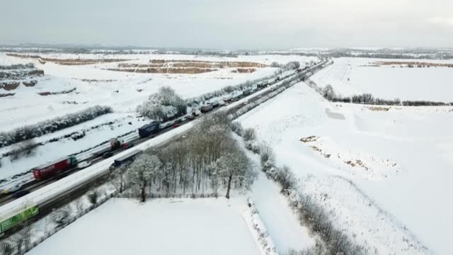 fields in northern england are covered in a thick blanket of snow, with temperatures dropping across the country - land stock videos & royalty-free footage