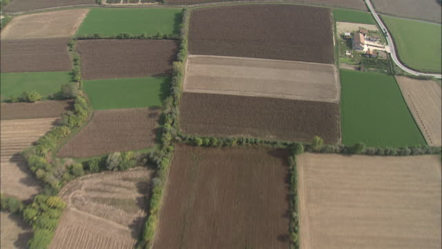 fields of crops create a patchwork pattern across the landscape. - patchwork stock videos & royalty-free footage