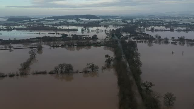 fields remain flooded near apperley, gloucestershire. bands of rain, sleet and snow were moving across the uk on tuesday morning, bringing dangerous... - extreme weather stock videos & royalty-free footage