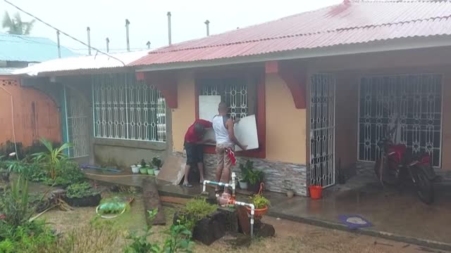 fierce winds and rain batter bilwi in northern nicaragua as local residents board up their homes in anticipation of iota, which has strengthened to a... - managua stock videos & royalty-free footage