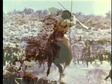 1963 REENACTMENT MONTAGE Fiere fighting during battle in Texas / AUDIO Revolution / 1830s Texas / AUDIO