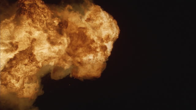 cu, slo mo fiery explosion against black background - fireball stock videos & royalty-free footage