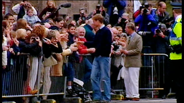 fife st andrews *** warning prince william signing autographs and along after joining st andrews university - autogramm stock-videos und b-roll-filmmaterial