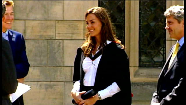 fife: st andrews: st andrews university: ext kate middleton, wearing graduation robes, standing next to her father michael middleton and talking to... - st. andrews scotland stock videos & royalty-free footage