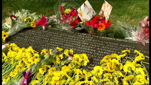 relatives hold ceremony england london hyde park ext close up of single yellow sunflowers and other tribute flowers laid on inscription plaque at... - memorial plaque stock videos and b-roll footage