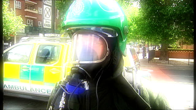 performance of emergency services england london emergency services ambulance man describing mass casualty oxygen unit / radiation detector / airwave... - emergency services vehicle stock videos and b-roll footage