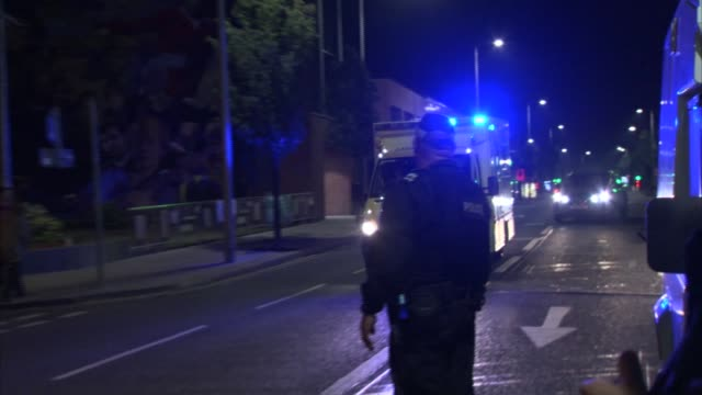 fifth night of disorder in londonderry and belfast northern ireland londonderry and belfast burntout cars in main road/ ambulance along street... - derry northern ireland stock videos & royalty-free footage