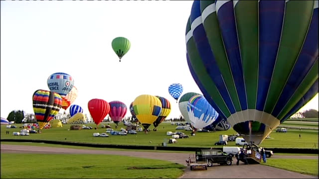 fifty balloonists cross english channel to set new world record england kent lydden hill race circuit ext hot air balloon being inflated wide shot... - world record stock videos and b-roll footage