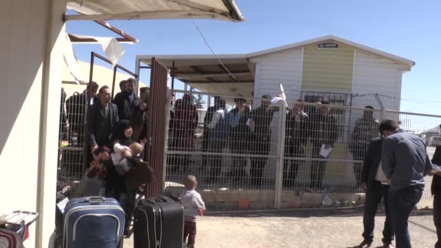 fifty displaced syrian refugees among them women and children return to their homeland through the oncupinar border gate in kilis turkey on april 04... - family with four children stock videos and b-roll footage