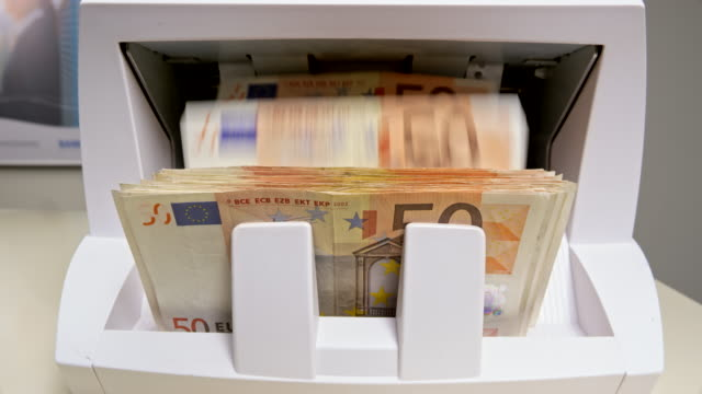 ld fifty euro banknotes coming out of the money counting machine and stacking up - banknote stock videos & royalty-free footage