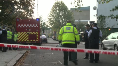 fifty people rescued from tower block fire in north kensington; england: london: kensington: ext fire officers and fire engine by adair tower flats... - smith tower stock-videos und b-roll-filmmaterial
