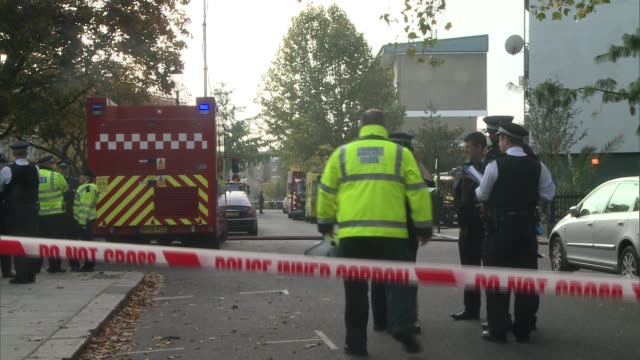 fifty people rescued from tower block fire in north kensington; england: london: kensington: ext fire officers and fire engine by adair tower flats... - smith tower stock videos & royalty-free footage