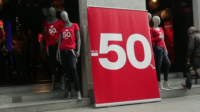 Fifty per cent discount signs are displayed outside a Desigual clothes store on the first day of sales in Madrid Spain on Tuesday Jan 7 General views...