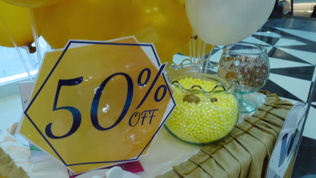 fifty percent discount , sign on balloon background, special offer in yellow color ,sale up to 50% off, special offer advertising for store or bar - store sign stock videos & royalty-free footage
