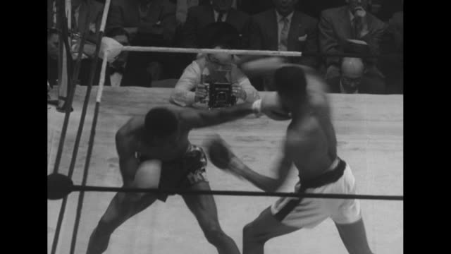 fight in progress at golden gloves intercity competition between chicago and new york at madison square garden; boxer orville pitts punching hosie... - all around competition stock videos & royalty-free footage