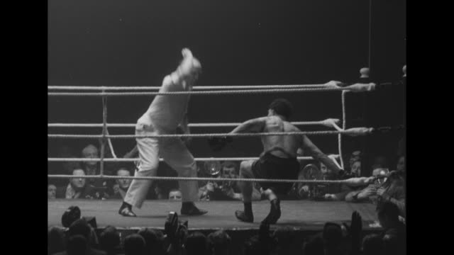 fight in progress between european heavyweight champion heinz neuhaus and british champion johnny williams / quick shot spectator yelling / williams... - exhilaration stock videos & royalty-free footage