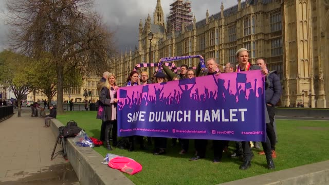 fight to save dulwich hamlet football club reaches parliament westminster houses of parliament ext victoria tower tilt down group of dulwich hamlet... - victoria tower stock-videos und b-roll-filmmaterial