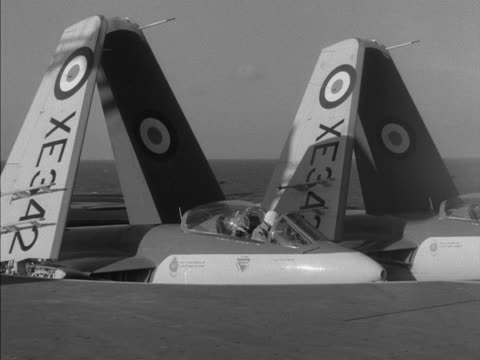 fighter aircraft descend on a lift from the deck of the ark royal - 船の一部点の映像素材/bロール