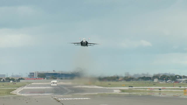 f18 fighter airplane takeoff from toronto - air force stock videos & royalty-free footage