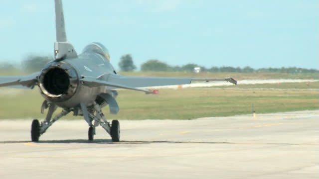 f16 fighter airplane taxi to the runway from behind - fighter stock videos and b-roll footage