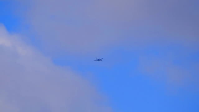 fighter flying in the sky. - supersonic airplane stock videos and b-roll footage