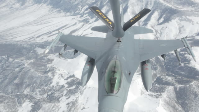 MS F-16 fighter jet flying away after mid-air refueling, Colorado Rockies, Colorado, USA
