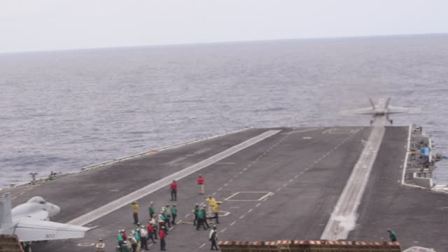 fighter jet takes off from us navy aircraft carrier in pacific ocean, wide shot - aircraft carrier stock videos & royalty-free footage