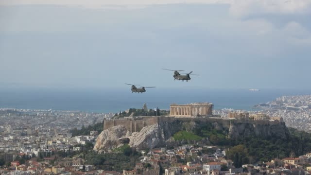 fighter jets and helicopters fly over the acropolis in athens while the bells of the church towers are ringing, thus marking greek independence day,... - fighter stock videos & royalty-free footage
